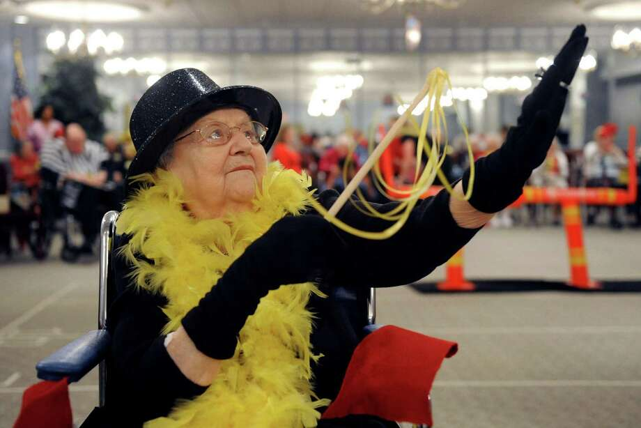 Nina White, age 90, performs with Destiny's Grandchild during the halftime show of the  Wheelchair Bowl X at Teresian House on Friday afternoon, Feb. 1, 2013, in Albany, N.Y. The Old Timers beat the Mavens 21-19. (Michael P. Farrell/Times Union) Photo: Michael P. Farrell