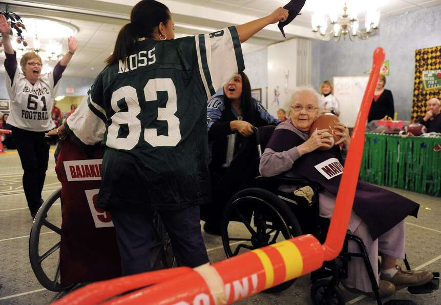 Mavens Rose Marie Jirard, age 91, goes in for a score during Wheelchair Bowl X at Teresian House on