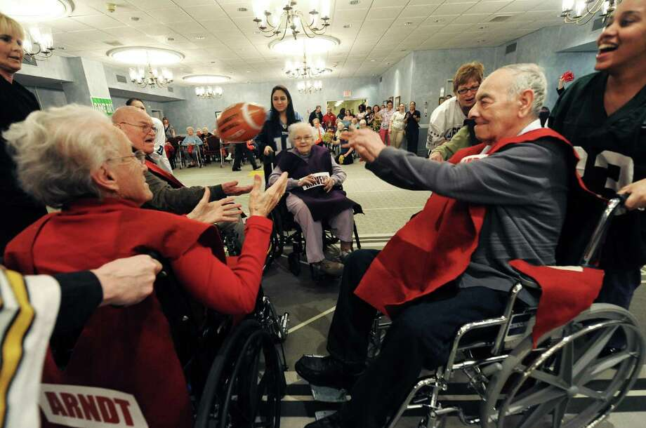 The Mavens and Old Timers square off during Wheelchair Bowl X at Teresian House on Friday afternoon, Feb. 1, 2013, in Albany, N.Y. The Old Timers beat the Mavens 21-19. (Michael P. Farrell/Times Union) Photo: Michael P. Farrell