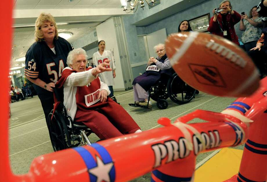 Old Timers Mabel Carcia, age 87, puts the extra point through the uprights during Wheelchair Bowl X at Teresian House Friday afternoon, Feb. 1, 2013, in Albany, N.Y. The Old Timers beat the Mavens 21-19. (Michael P. Farrell/Times Union) Photo: Michael P. Farrell