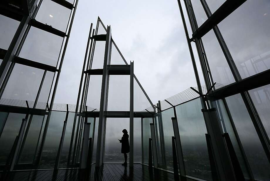 A woman looks out over London from the View from the Shard on it's opening morning on February 1, 2013 in London, England. Level 72 is the highest viewing gallery in The View from The Shard, and the highest vantage point in Western Europe.  Photo: Matthew Lloyd, Getty Images