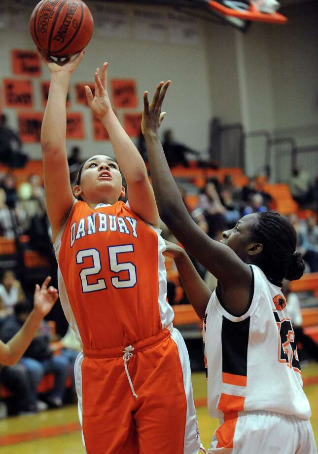 Danbury's Kayla Handberry takes a shot during Friday's game at Stamford High School on February 1, 2013. Photo: Lindsay Perry / Stamford Advocate