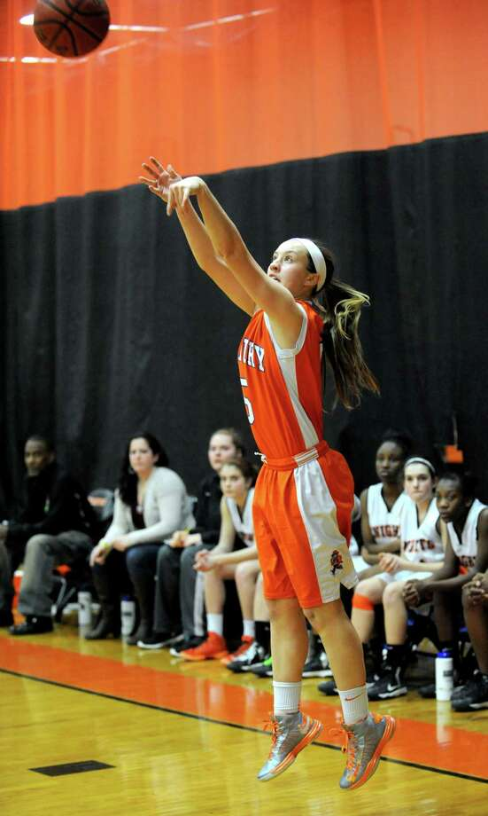 Danbury's Rachel Gartner takes a shot during Friday's game at Stamford High School on February 1, 2013. Photo: Lindsay Perry / Stamford Advocate
