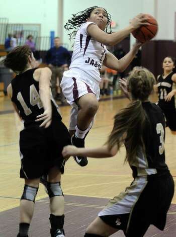 Lady Jaguar Malena Washington, #1, puts it up for two during the Central High School girls basketball game against Vidor High School on February 1, 2013, at Central High School. Central won over Vidor 70 -46. Photo taken: Randy Edwards/The Enterprise Photo: Randy Edwards