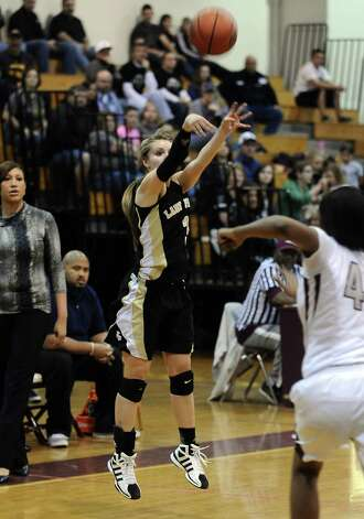 Lady Pirate Allison Jacks, #3, puts it up for three during the Central High School girls basketball game against Vidor High School on February 1, 2013, at Central High School. Central won over Vidor 70 -46. Photo taken: Randy Edwards/The Enterprise Photo: Randy Edwards