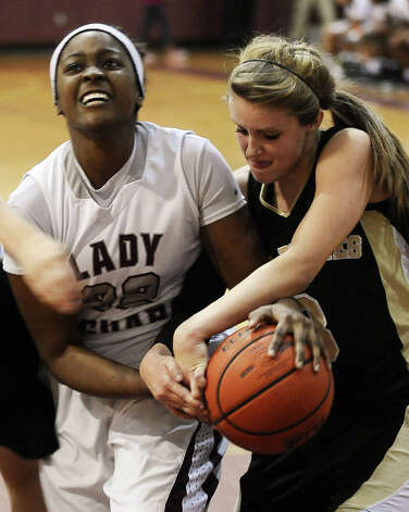 Lady Jaguar Briawna Butler, #22, and Lady Pirate Allison Jacks, #3, fight for the ball during the Central High School girls basketball game against Vidor High School on February 1, 2013, at Central High School. Central won over Vidor 70 -46. Photo taken: Randy Edwards/The Enterprise Photo: Randy Edwards
