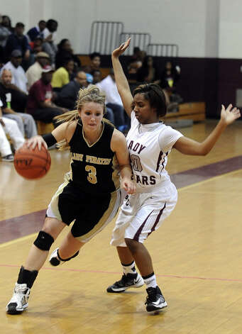 Lady Pirate Allison Jacks, #3, drives to the gal past Lady Jaguar Aliyah Ozane, #00, during the Central High School girls basketball game against Vidor High School on February 1, 2013, at Central High School. Central won over Vidor 70 -46. Photo taken: Randy Edwards/The Enterprise Photo: Randy Edwards