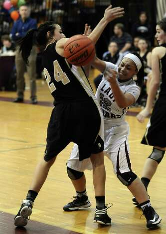 Lady Jaguar Tierra Douglas, #12, looks to pass during the Central High School girls basketball game against Vidor High School on February 1, 2013, at Central High School. Central won over Vidor 70 -46. Photo taken: Randy Edwards/The Enterprise Photo: Randy Edwards