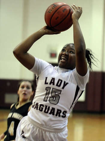 Lady Jaguar Breasia Allison, #15, puts it up for two during the Central High School girls basketball game against Vidor High School on February 1, 2013, at Central High School. Central won over Vidor 70 -46. Photo taken: Randy Edwards/The Enterprise Photo: Randy Edwards