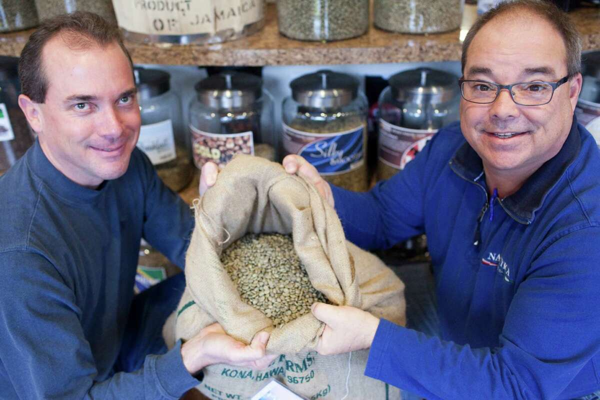 Mike Ferguson, left, and Paul Endres own Southern Refreshment. They have two outlets called CoffeeIcon Superstores, which offer about a dozen single-sourced coffee beans. The most expensive coffee, Kona, sells for about $40 a pound.Mike Ferguson, left, and Paul Endres own Southern Refreshment. They have two outlets called CoffeeIcon Superstores, which offer about a dozen single-sourced coffee beans. The most expensive coffee, Kona, sells for about $40 a pound.Mike Ferguson, left, and Paul Endres own Southern Refreshment. They have two outlets called CoffeeIcon Superstores, which offer about a dozen single-sourced coffee beans. The most expensive coffee, Kona, sells for about $40 a pound.
