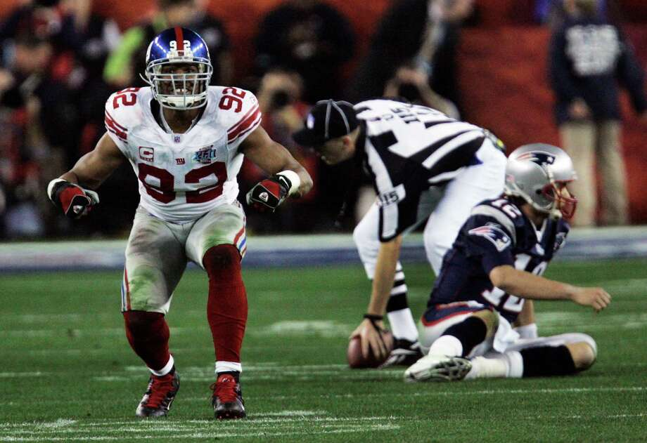 Former TSU and Giants defensive end Michael Strahan (92) left many a quarterback in his wake, including Tom Brady in his final season, which culminated in a Super Bowl win over the Patriots. Photo: David Duprey, STF / AP
