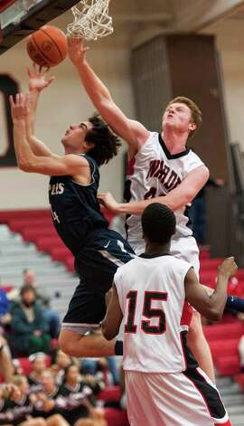 Fairfield Warde high school's Brian Kerrigan goes up to try an block a shot by Staples high school's James Frusciante in a boys basketball game played at Fairfield Warde high school, Fairfield, CT on Friday February 1st, 2013. Photo: Mark Conrad / Connecticut Post Freelance