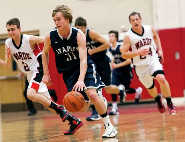 Staples high school's Peter Rankowitz moves the ball up court during a boys basketball game against Fairfield Warde high school played at Fairfield Warde high school, Fairfield, CT on Friday February 1st, 2013. Photo: Mark Conrad / Connecticut Post Freelance