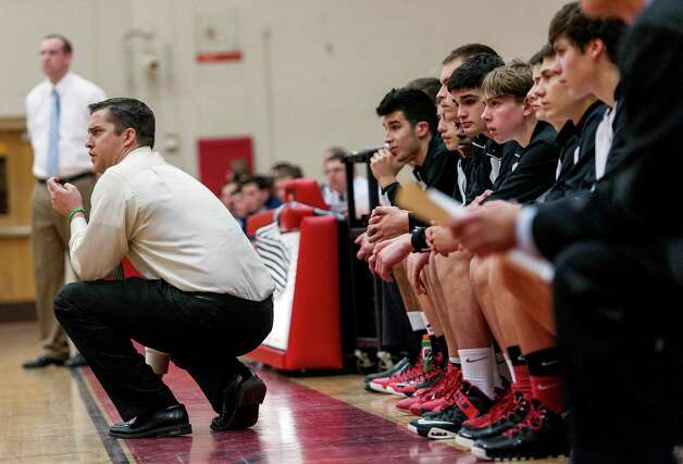 Fairfield Warde high school boys basketball head coach Ryan Swaller during a game against Staples high school played at Fairfield Warde high school, Fairfield, CT on Friday February 1st, 2013. Photo: Mark Conrad / Connecticut Post Freelance