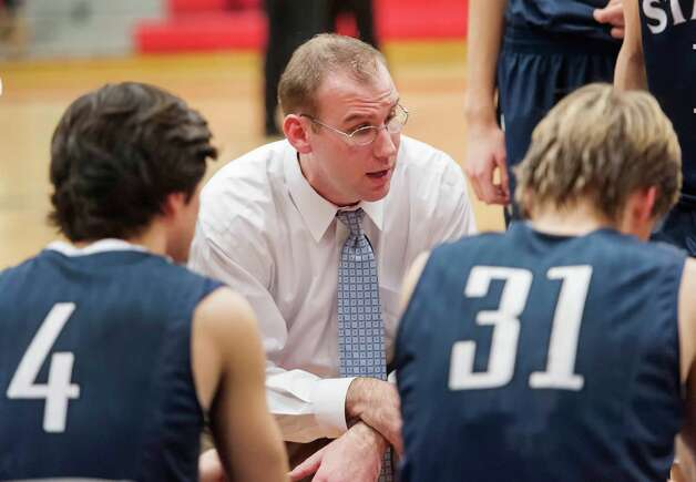 Staples high school boys basketball head coach Colin Devine during a game against Fairfield Warde high school played at Fairfield Warde high school, Fairfield, CT on Friday February 1st, 2013. Photo: Mark Conrad / Connecticut Post Freelance