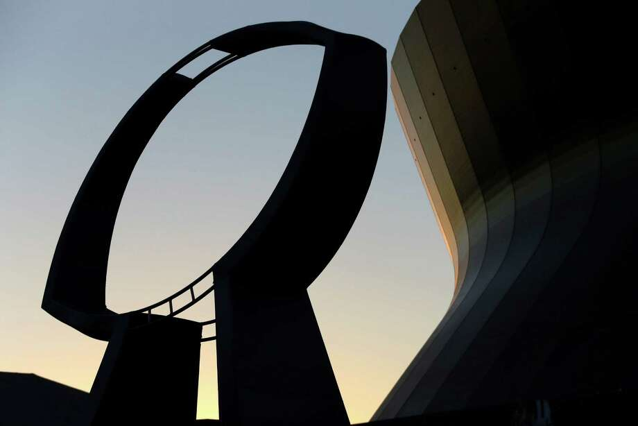 A statue depicting the Vince Lombardi Super Bowl Trophy stands outside the Mercedes-Benz Superdome at sunset on Friday, Feb. 1, 2013, in New Orleans. The Baltimore Ravens are to play the San Francisco 49ers in NFL football's Super Bowl XLVII on Sunday at the Superdome. (AP Photo/Gene J. Puskar) Photo: Gene J. Puskar