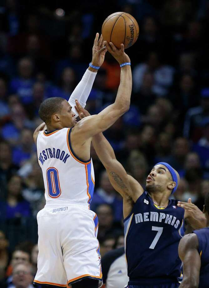 Oklahoma City Thunder guard Russell Westbrook (0) shoots over Memphis Grizzlies guard Jerryd Bayless (7) in the second quarter of an NBA basketball game in Oklahoma City, Thursday, Jan. 31, 2013. Oklahoma City won 106-89. (AP Photo/Sue Ogrocki) Photo: Sue Ogrocki