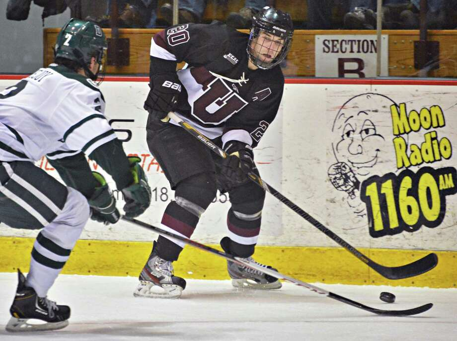 Union's #20 Greg Coburn gets a shot past Dartmouth's #2 Nick Lovejoy, left, during Friday's game at Messa Rink in Schenectady Feb. 1, 2013.  (John Carl D'Annibale / Times Union) Photo: John Carl D'Annibale / 00020976A