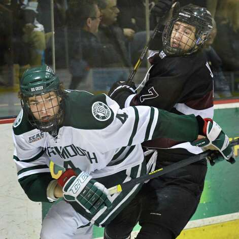 Dartmouth's #4 Geoff Ferguson, left, and Union's #7 Josh Jooris during Friday's game at Messa Rink in Schenectady Feb. 1, 2013.  (John Carl D'Annibale / Times Union) Photo: John Carl D'Annibale / 00020976A