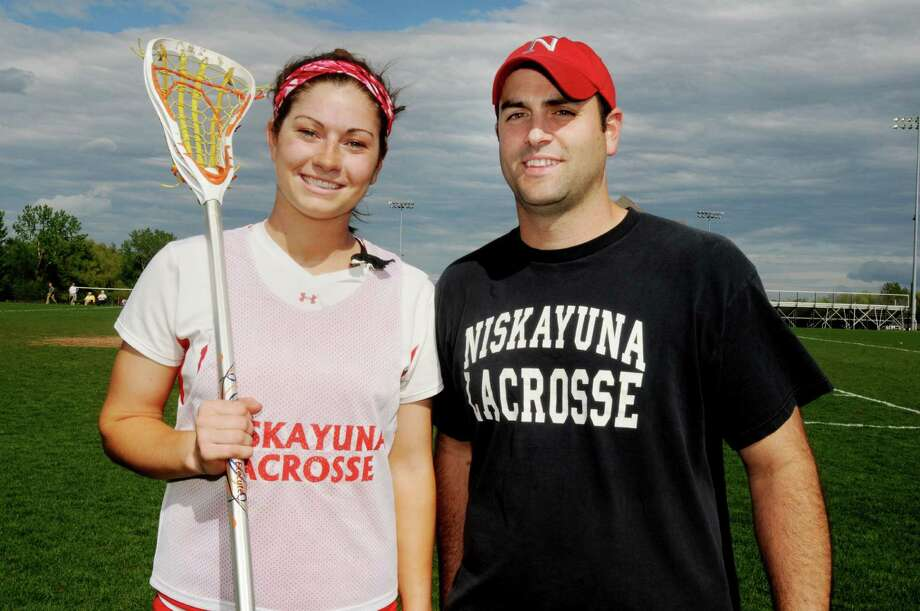 L-R: Kayla Treanor, a sophomore star on the Niskayuna High School Girls Lacrosse Team with her coach Peter Melito before the start of a game vs. Guilderland High School at home on Monday, May 3, 2010, in Niskayuna, NY.   Kayla who still has over two years of high school to complete is already attracting the attention of some college scouts from Division One teams like University of North Carolina, Syracuse and Siena.      (Luanne M. Ferris / Times Union) Photo: LUANNE M. FERRIS / 00008559A