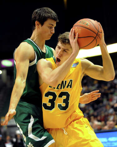 Siena's Rob Poole (33), right, pushes for room as Manhattan's Shane Richards (0) defends during their basketball game on Friday, Feb. 1, 2013, at Times Union Center in Albany, N.Y. Siena wins 66-63. (Cindy Schultz / Times Union) Photo: Cindy Schultz / 00020987A
