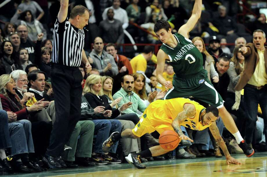 Siena's Rakeem Brookins (12), center, draws a foul from Manhattan's Shane Richards (0) as the clock winds down during their basketball game on Friday, Feb. 1, 2013, at Times Union Center in Albany, N.Y. (Cindy Schultz / Times Union) Photo: Cindy Schultz / 00020987A