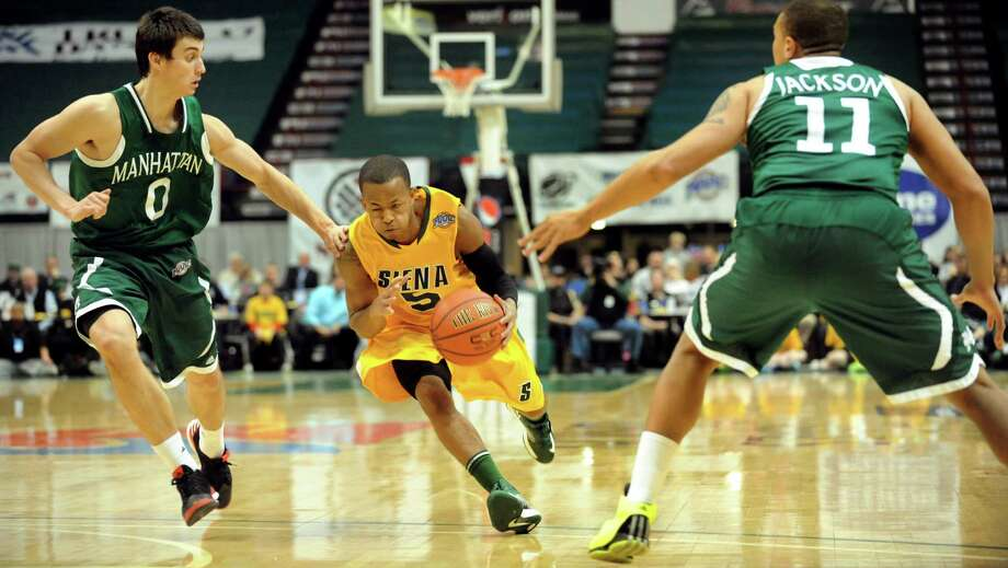 Siena's Evan Hymes (5), center, drives between Manhattan's Shane Richards (0), left, and Mark Jackson Jr. (11) during their basketball game on Friday, Feb. 1, 2013, at Times Union Center in Albany, N.Y. (Cindy Schultz / Times Union) Photo: Cindy Schultz / 00020987A