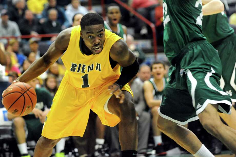 Siena's O.D. Anosike (1) looks to pass during their basketball game against Manhattan on Friday, Feb. 1, 2013, at Times Union Center in Albany, N.Y. (Cindy Schultz / Times Union) Photo: Cindy Schultz / 00020987A
