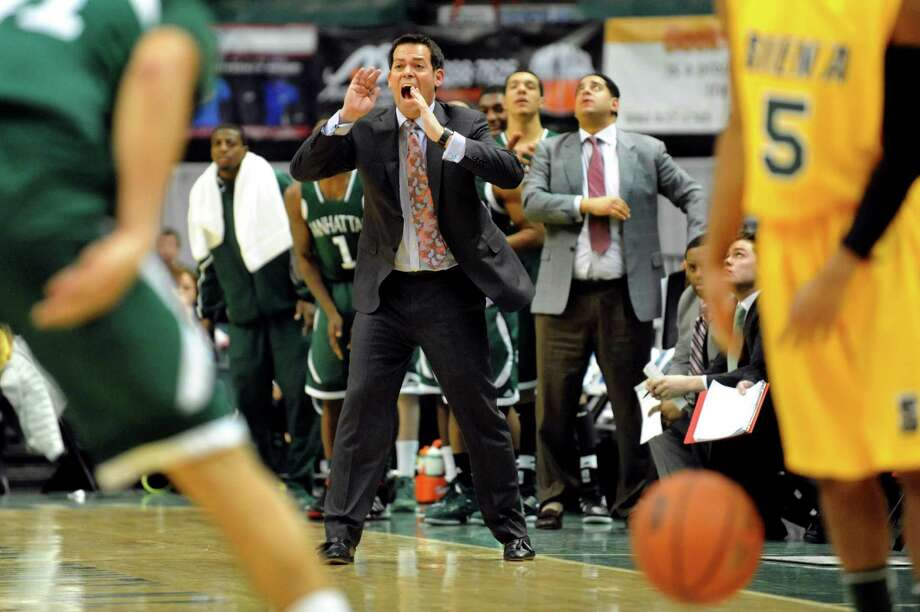 Manhattan's coach Steve Masiello, center, encourages his team during their basketball game against Siena on Friday, Feb. 1, 2013, at Times Union Center in Albany, N.Y. (Cindy Schultz / Times Union) Photo: Cindy Schultz / 00020987A