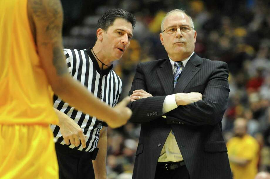 Siena's coach Mitch Buonaguro, right, checks in with an official during their basketball game against Manhattan on Friday, Feb. 1, 2013, at Times Union Center in Albany, N.Y. (Cindy Schultz / Times Union) Photo: Cindy Schultz / 00020987A