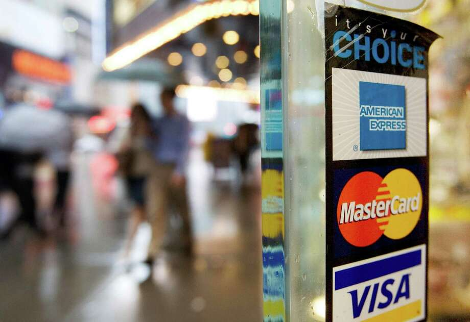 Master Card and Visa, along with major banks were sued by merchants over credit card surcharges ranging from 1.5 percent to 4 percent. Photo: Mark Lennihan, STF / AP