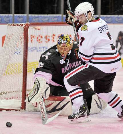 Rockford IceHogs' Brandon Svendsen (7) chases the puck past San Antonio Rampage goaltender Jacob Markstrom during the third period of an AHL hockey game, Friday, Feb. 1, 2013, in San Antonio. San Antonio won 1-0. (Darren Abate/pressphotointl.com) Photo: Darren Abate, For The Express-News / Darren Abate/pressphotointl.com