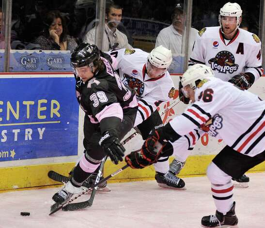San Antonio Rampage's Justin Vaive (39) chases the puck ahead of Rockford IceHogs players during the second period of an AHL hockey game, Friday, Feb. 1, 2013, in San Antonio. (Darren Abate/pressphotointl.com) Photo: Darren Abate, For The Express-News / Darren Abate/pressphotointl.com