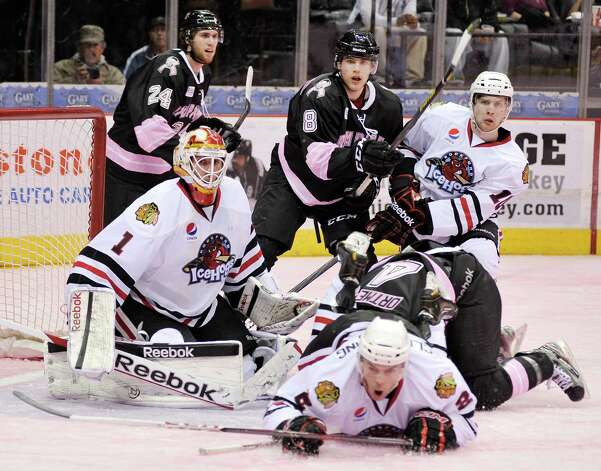 Rockford IceHogs goaltender Henrik Karlsson (1) keeps an eye on the puck as San Antonio Rampage's Mike Santorelli (8) and Quinton Howden (24) look for a pass during the second period of an AHL hockey game, Friday, Feb. 1, 2013, in San Antonio. (Darren Abate/pressphotointl.com) Photo: Darren Abate, For The Express-News / Darren Abate/pressphotointl.com