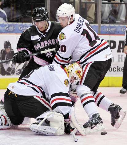 Rockford IceHogs goaltender Henrik Karlsson (1) and Rockford's Klas Dahlbeck (10), defend the net from San Antonio Rampage's Mike Santorelli during the second period of an AHL hockey game, Friday, Feb. 1, 2013, in San Antonio. (Darren Abate/pressphotointl.com) Photo: Darren Abate, For The Express-News / Darren Abate/pressphotointl.com