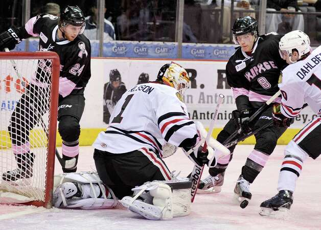 Rockford IceHogs goaltender Henrik Karlsson (1) and Rockford's Klas Dahlbeck, right, defend the net from San Antonio Rampage's Mike Santorelli (8) and Quinton Howden during the second period of an AHL hockey game, Friday, Feb. 1, 2013, in San Antonio. (Darren Abate/pressphotointl.com) Photo: Darren Abate, For The Express-News / Darren Abate/pressphotointl.com