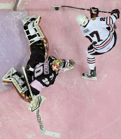 San Antonio Rampage goaltender Jacob Markstrom (30) makes a save on Rockford IceHogs' Brandon Pirri during the first period of an AHL hockey game, Friday, Feb. 1, 2013, in San Antonio. (Darren Abate/pressphotointl.com) Photo: Darren Abate, For The Express-News / Darren Abate/pressphotointl.com