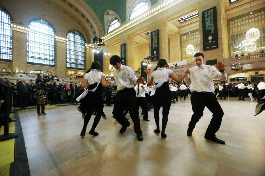 NEW YORK, NY - FEBRUARY 01:  Young ballroom dancers from Dancing Classrooms dance in Grand Central Terminal during centennial celebrations on the day the famed Manhattan transit hub turns 100 years old on February 1, 2013 in New York City. The terminal opened in 1913 and is the world's largest terminal covering 49 acres with 33 miles of track. Each day 700,000 people pass through the terminal where Metro-Noth Railroad operates 700 trains per day. Photo: Mario Tama, Getty Images / 2013 Getty Images