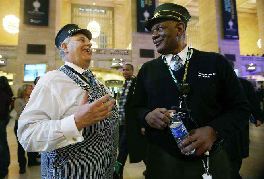 NEW YORK, NY - FEBRUARY 01:  Retired Amtrak conductor Tom Savio (L) talks with Metro-North Railroad representative Melvin Johnson in Grand Central Terminal during centennial celebrations on the day the famed Manhattan transit hub turns 100 years old on February 1, 2013 in New York City. The terminal opened in 1913 and is the world's largest terminal covering 49 acres with 33 miles of track. Each day 700,000 people pass through the terminal where Metro-Noth Railroad operates 700 trains per day. Photo: Mario Tama, Getty Images / 2013 Getty Images