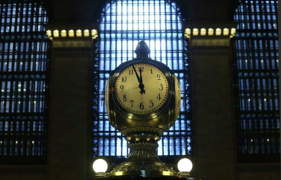 NEW YORK, NY - JANUARY 31:  The clock above the Grand Central Terminal Information Booth, with faces made of opal, ticks on the day before the famed Manhattan transit hub turns 100 years old on January 31, 2013 in New York City. The terminal opened in 1913 and is the world's largest terminal covering 49 acres with 33 miles of track. Each day 700,000 people pass through the terminal where Metro-North Railroad operates 700 trains per day. Photo: Mario Tama, Getty Images / 2013 Getty Images