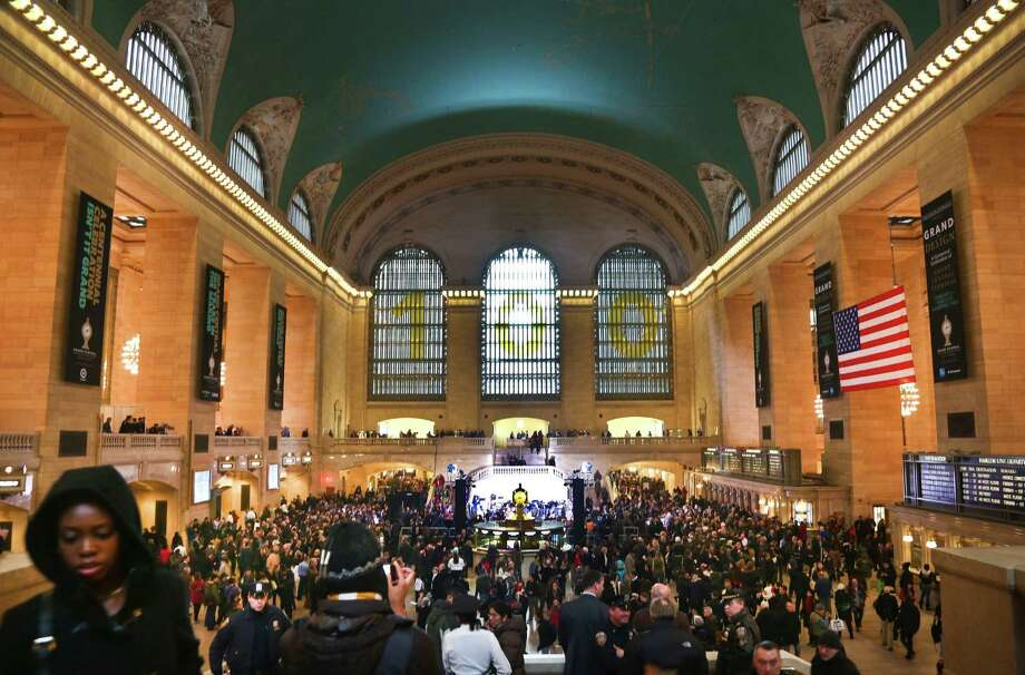 Crowds gather as Grand Central Terminal kicks off its centennial celebration on Friday, Feb. 1, 2013 in New York. New Yorkers are celebrating the 100th birthday of Grand Central terminal with music, speeches and a cake shaped like the main concourse's famous clock. Photo: Bebeto Matthews, AP / AP