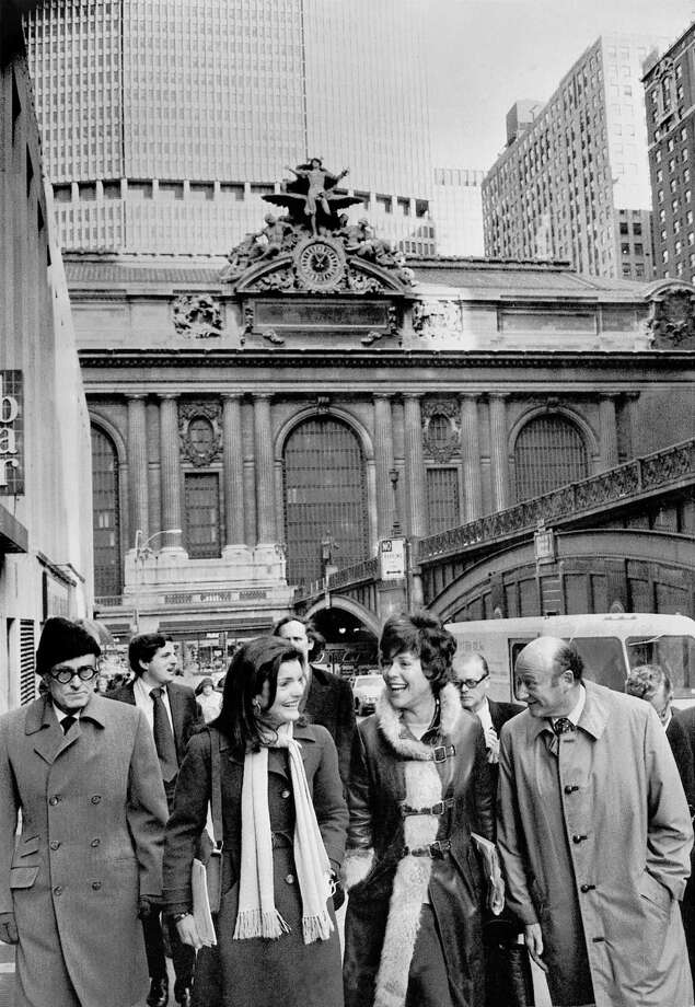 The fate of Grand Central Terminal, threatened by the wrecker's ball, spurred a preservation campaign steered by Philip Johnson, left, Jacqueline Kennedy Onassis, Bess Myerson and then-Congressman Edward I.  Koch, among many others. The four are seen walking up Park Avenue from the terminal (in the background) in 1975. Koch, who parlayed shrewd political instincts and plenty of chutzpah into three tumultuous terms as mayor of New York, died Friday morning, Feb. 1, 2013, at age 88. (Jack Manning/The New York Times) Photo: JACK MANNING, NYT / NYTNS