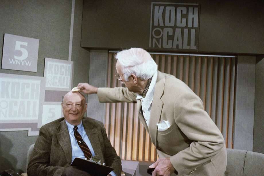 "FILE - In this March 15, 1987, file photo, New York Mayor Ed Koch gets his head powered by a make-up artist before the start of his new television call-in program, ""Koch on Call"" at New York's Channel 5. Koch, the combative politician who rescued the city from near-financial ruin during three City Hall terms, has died at age 88. Spokesman George Arzt says Koch died Friday morning Feb. 1, 2013 of congestive heart failure. (AP Photo/Frank Franklin II, File) Photo: David Bookstaver, AP / AP"