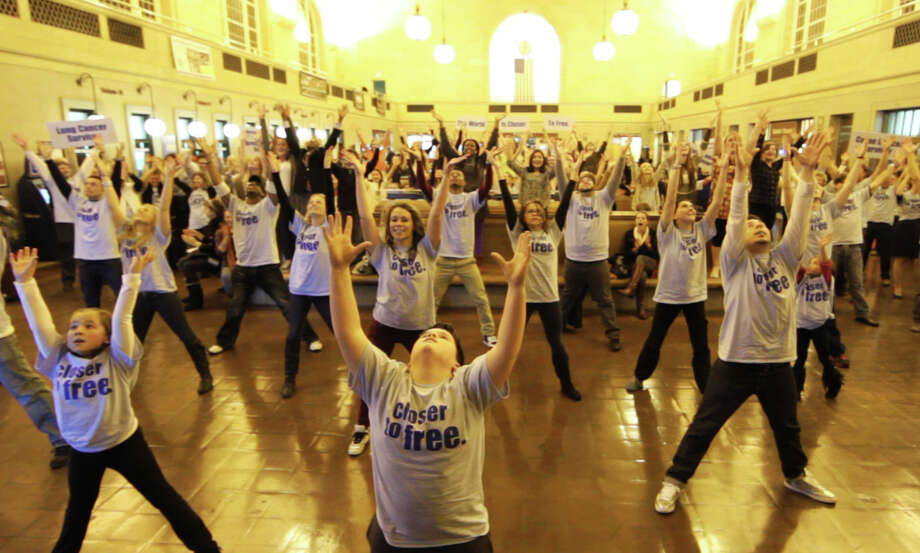 "A ""flash mob"" by the Fairfield County Children's Choir, filmed at Union Railroad Station in New Haven, will be broadcast as a commercial for the Smilow Cancer Hospital during Sunday's Super Bowl. Photo: Contributed Photo / Fairfield Citizen contributed"