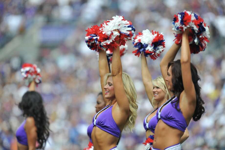 Cheerleaders for the Baltimore Ravens cheer before the game against the Pittsburgh Steelers at M&T Bank Stadium on September 11, 2011 in Baltimore, Maryland. The Ravens defeated the Steelers 35-7. Photo: Larry French, Getty Images / 2011 Getty Images