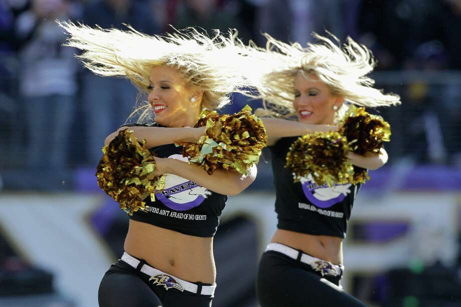 Members of the Baltimore Ravens cheerleaders perform during the first half of the Ravens and Arizona Cardinals game at M&T Bank Stadium on October 30, 2011 in Baltimore, Maryland. The Baltimore won 30-27. Photo: Rob Carr, Getty Images / 2011 Getty Images