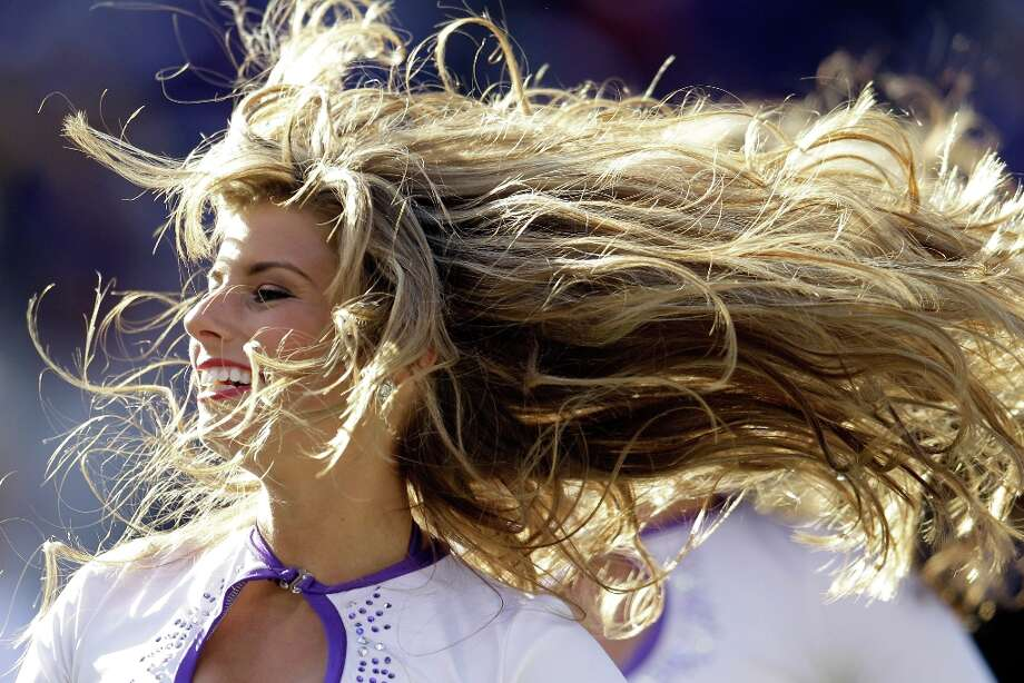 A Baltimore Ravens cheerleader performs during the first half of the Ravens and Indianapolis Colts game at M&T Bank Stadium on December 11, 2011 in Baltimore, Maryland. Photo: Rob Carr, Getty Images / 2011 Getty Images