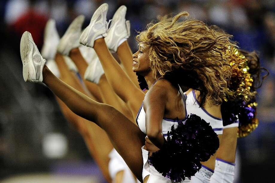 Baltimore Ravens cheerleaders dance during a timeout in a game against the Jacksonville Jaguars at M&T Bank Stadium on August 23, 2012 in Baltimore, Maryland. The Baltimore Ravens won, 48-17. Photo: Patrick Smith, Getty Images / 2012 Getty Images