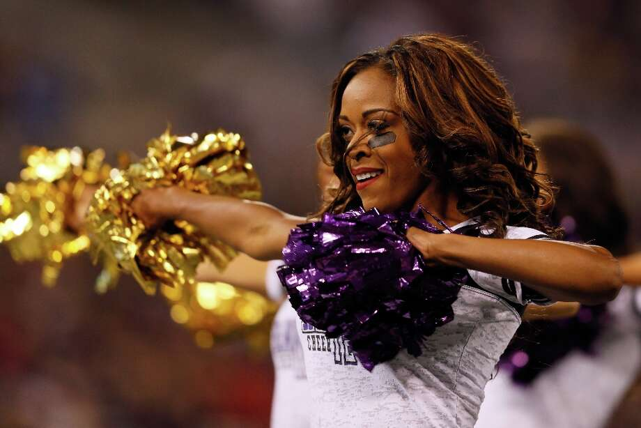 A Baltimore Ravens cheerleader performs during the second half of the Ravens and New England Patriots game at M&T Bank Stadium on September 23, 2012 in Baltimore, Maryland. Photo: Rob Carr, Getty Images / 2012 Getty Images