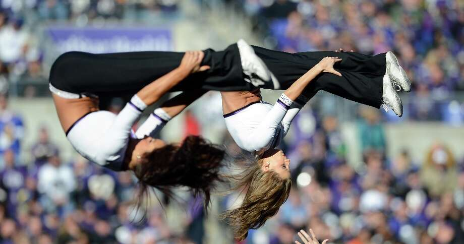 Cheerleaders for the Baltimore Ravens perform against the Indianapolis Colts during the AFC Wild Card Playoff Game at M&T Bank Stadium on January 6, 2013 in Baltimore, Maryland. Photo: Patrick Smith, Getty Images / 2013 Getty Images